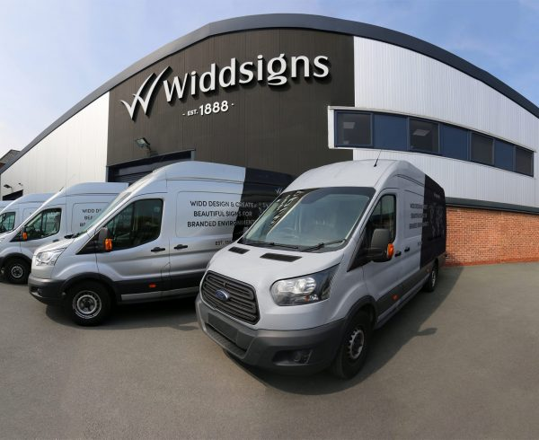 Widd Signs factory with transit vans outside